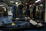 U.S. Sailors provide simulated medical attention during a mass casualty drill aboard the aircraft carrier USS Nimitz (CVN 68) in the Indian Ocean June 3, 2013 130603-N-LP801-035.jpg
