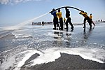 U.S. Sailors wash the flight deck of the aircraft carrier USS Ronald Reagan (CVN 76) July 22, 2013, while underway in the Pacific Ocean carrier qualifications 130722-N-ZZ999-278.jpg