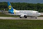 UR-GAW Boeing B737-5YD B735 - AUI (18642682536).jpg