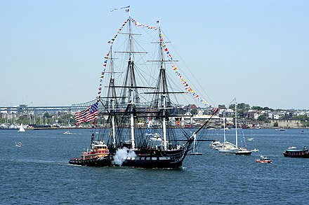 USS Constitution fires a salute during its annual Fourth of July turnaround cruise. USS Constitution salutes Bataan 2005.jpg