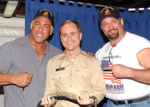 Chuck Palumbo - Palumbo (left) and Big Boss Man (right) present Captain Doug Dupuoy of the U.S. Navy a WWF Championship Belt in 2002.