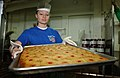 US Navy 021205-N-1328C-504 pulling out a fresh tray of Pineapple Upside Down Cake.jpg