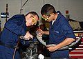 US Navy 030618-N-3970R-001 Aviation Structural Mechanic 2nd Class Jason Lively and Aviation Mechanic Airman Rafael Bustamente work together to rivet an air baffle.jpg