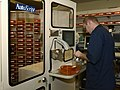 US Navy 030819-N-9593R-102 Hospitalman Randy Connelly, of Breezewood, Penna., refills a medication bin for the Autoscript III robot at the National Naval Medical Center in Bethesda, Maryland.jpg