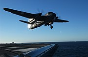 """US Navy 040617-N-8213G-113 An Argentine Navy S-2 Tracker aircraft performs a """"touch and go"""" landing during flight operations aboard the Nimitz-class aircraft carrier USS Ronald Reagan (CVN 76)"""