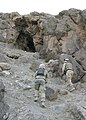 US Navy 040627-M-8096M-012 U.S. Marines approach a cave to search for hidden weapons caches.jpg