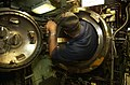 US Navy 040817-N-6811L-020 Machinist's Mate 3rd Class Nicholas Thesing, assigned to USS Portsmouth (SSN 707), enters a torpedo tube for a pre-load inspection.jpg