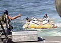 US Navy 042904-N-7034S-015 Sailors assigned to Naval Amphibious Base Little Creek's Special Boat Unit Two Zero (SBU-20) recover a Rigid Hull Inflatable Boat (RHIB) platform just after splashdown.jpg