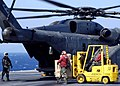 US Navy 050125-N-9079D-069 Sailors aboard USS Abraham Lincoln (CVN 72) load supplies onto a MH-53E Sea Dragon helicopter, assigned to the Blackhawks of Helicopter Mine Countermeasures Squadron Fifteen (HM-15), in support of Ope.jpg