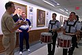US Navy 051007-N-2383B-126 Chief of Naval Operations (CNO) Adm. Mike Mullen, says a few words to the visiting U.S. Air Force Cadet Drum and Bugle Corps as they perform in the Pentagon corridors.jpg