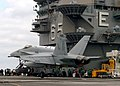 US Navy 051017-N-0119G-017 An F-A-18C Hornet assigned to the Sidewinders of Strike Fighter Squadron Eight Six (VFA-86) lands on the flight deck of the nuclear-powered aircraft carrier USS Enterprise (CVN 65).jpg