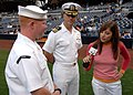 US Navy 060422-N-0716S-003 News Anchor Chrissy Russo, from Fox 6 news in San Diego interviews Aviation Boatswains Mate Handling 3rd Class (ABH3) Brandon Dow.jpg