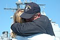 US Navy 060502-N-0924R-075 Storekeeper 1st Class Carlos Olivari, assigned aboard the guided missile cruiser USS Leyte Gulf (CG 55), hugs his wife before the ship departs Naval Station Norfolk.jpg