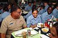 US Navy 060831-N-4124C-070 Commander, Amphibious Forces 7th Fleet Rear Adm. Victory G. Guillory shares lunch with Sailors assigned to the amphibious assault ship USS Essex (LHD 2).jpg