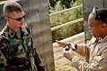 US Navy 061115-N-0553R-003 U.S. Marine Master Sgt. Carl Holden, stationed with Special Operations Training Group, 3rd Marine Expeditionary Force, uses a practice grenade to demonstrate to Equipment Operator 2nd Class Justin Joh.jpg