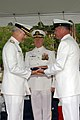 US Navy 070615-N-2147L-003 Force Master Chief Jeff Vandervort, right, presents Vice Adm. James D. McArthur Jr. with his flag.jpg