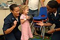 US Navy 070623-N-7088A-036 Capt. Wanda Richards and Chief Hospital Corpsman Tracey Lewis play with a young child in a playroom aboard the Military Sealift Command hospital ship USNS Comfort (T-AH 20).jpg