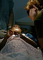 US Navy 070904-N-6278K-161 Canadian Forces Cpl. Julie Belisle, a dental technician attached to Military Sealift Command (MSC) hospital ship USNS Comfort (T-AH 20), calms a patient before a tooth extraction at Hôpital.jpg