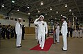 US Navy 070918-N-0021M-001 Rear Adm. Thomas S. Rowden is piped ashore after relieving Rear Adm. James P. Wisecup as commander of U.S. Naval Forces Korea during a change of command ceremony in Collier Field House.jpg