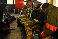 US Navy 071024-N-2638R-003 Sailors assigned to the submarine tender USS Frank Cable (AS 40), prepare their self-contained breathing apparatuses (SCBA) during an advanced shipboard fire fighting course at the Center for Naval En.jpg