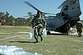 US Navy 071126-N-1831S-104 A member of the Bangladesh Army helps unload bags of purified water from a CH-46 Sea Knight assigned to the amphibious assault ship USS Kearsarge (LHD 3).jpg