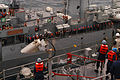 US Navy 080612-N-5831F-215 Sailors aboard the amphibious dock landing ship USS Tortuga (LSD 46) secure a shot line to establish communication with Royal Thai Navy as part of Cooperation Afloat and Readiness Training 2008.jpg