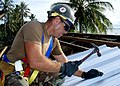 US Navy 080825-N-2941Y-001 Builder 2nd Class Gabriel Kellyinstalls a roof on the Mwan Elementary School in Chuuk.jpg