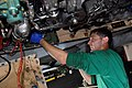 US Navy 080831-N-7730P-010 viation Machinist's Mate 3rd Class Jeremy Dean removes connecting hardware.jpg