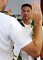 US Navy 080902-N-9758L-046 Native Hawaiian Cmdr. Mel Yokoyama, executive officer of Cruise Missile Support Activity, Pacific, listens to the oath of appointment during his promotion ceremony at the U.S. Pacific Fleet boathouse.jpg