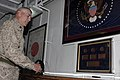 US Navy 081208-M-6412J-391 Actor and Marine Corps icon Gunnery Sgt. R. Lee Ermey looks at artifacts from the battle of Iwo Jima.jpg