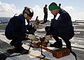 US Navy 090115-N-9758L-576 Sailors assigned to the guided-missile cruiser USS Chosin (CG 65) adjust a chock and chain for an incoming helicopter during the Commander, Naval Surface Group Middle Pacific Surface Combatant Group S.jpg