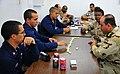 US Navy 090326-N-4774B-287 Sailors assigned to the guided-missile cruiser USS Lake Champlain (CG 57) play dominoes with Iraqi Marines aboard the Khawr Al Amaya Oil Terminal off the coast of Iraq during an Iraqi-Coalition event.jpg