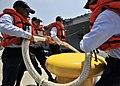 US Navy 090520-N-2638R-002 Sailors remove a mooring line from a bollard as the aircraft carrier USS George Washington (CVN 73) departs Commander, Fleet Activities Yokosuka for a scheduled underway.jpg