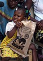 US Navy 100120-N-4971L-086 A Haitian girl enjoys her meal-ready-to-eat that U.S. service members distributed to Haitian citizens who live in the village of Birey.jpg