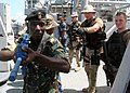 US Navy 100120-N-6060O-003 Tanzanian Navy Cpl. Shaban Kahesi leads his visit, board, search and seizure (VBSS) class during a compliant boarding exercise aboard the Africa Partnership Station (APS) East platform, the guided-mi.jpg