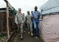 US Navy 100306-N-5961C-013 Gen. Douglas Fraser, left, commander of U.S. Southern Command, tours the Camp Ancien internally displaced person's camp in Port-au-Prince, Haiti.jpg