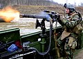 US Navy 100328-N-4153W-196 Gunner's Mate 3rd Class Geoffrey Martin fires a GAU-17A gun from the bow of a riverine assault boat during live fire battle drills at Fort Knox, Ky.jpg