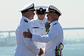 US Navy 100812-N-7605J-174 Rear Adm. Tom Rowden and Command Master Chief Mark Rudes congratulate Commanding Officer Capt. Kenneth J. Norton.jpg
