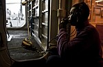 US Navy 101221-N-7981E-606 Aviation Boatswain's Mate (Fuel) Airman Spenser Hood communicates with a fuel pump room via a sound-powered phone from a.jpg