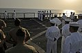 US Navy 110822-N-AG285-321 Sailors and Marines stand at parade rest during a burial at sea ceremony for three U.S. Navy veterans aboard the amphibi.jpg