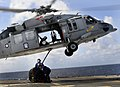 US Navy 111208-N-BC134-131 Sailors aboard the guided-missile cruiser USS Bunker Hill (CG 52) connect a cargo pendant on an MH-60 Sea Hawk helicopte.jpg