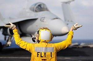 US Navy 111231-N-GZ832-582 Aviation Boatswain's Mate (Handling) 3rd Class Alexis Lebrake, assigned to the air department aboard the aircraft carrie.jpg