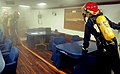 US Navy 120203-N-RN782-475 A Sailor relays instructions during a firefighting training drill.jpg