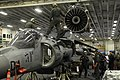 US Navy 120207-N-VG904-060 Marines from Marine Attack Squadron (VMA) 542 hoist an engine out of an AV-8B Harrier for maintenance in the hangar bay.jpg