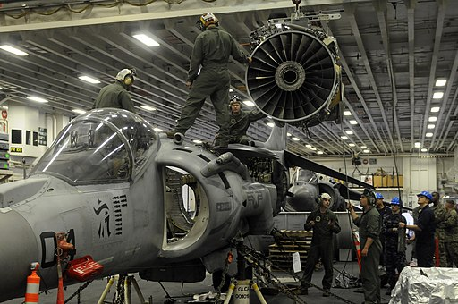 US Navy 120207-N-VG904-060 Marines from Marine Attack Squadron (VMA) 542 hoist an engine out of an AV-8B Harrier for maintenance in the hangar bay
