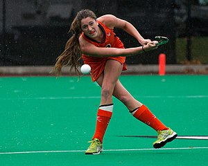 Field hockey - A Virginia Cavaliers field player passing the ball