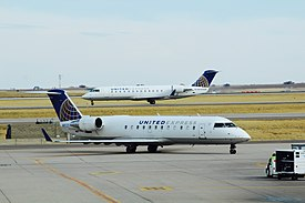 United Express Bombardier CRJ 200s at Denver International Airport.jpg