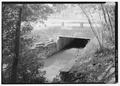 VIEW FROM SOUTHEAST OF DOWNSTREAM SIDE OF WORMLEY POND DAM. - Yorktown Battlefield Tour Roads, Yorktown, York County, VA HAER VA,100-YORK.V,2-12.tif