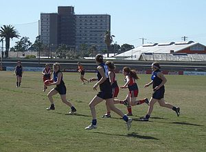Melbourne University Mugars - Players in action at the 2005 VWFL Division One Reserves Grand Final: Melbourne University Mugars (black and blue) defeated the Darebin Falcons (red and black).