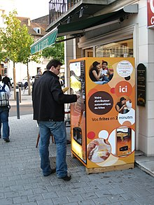 Side view of a Just Fries brand vending machine in Valenciennes, France (2008)